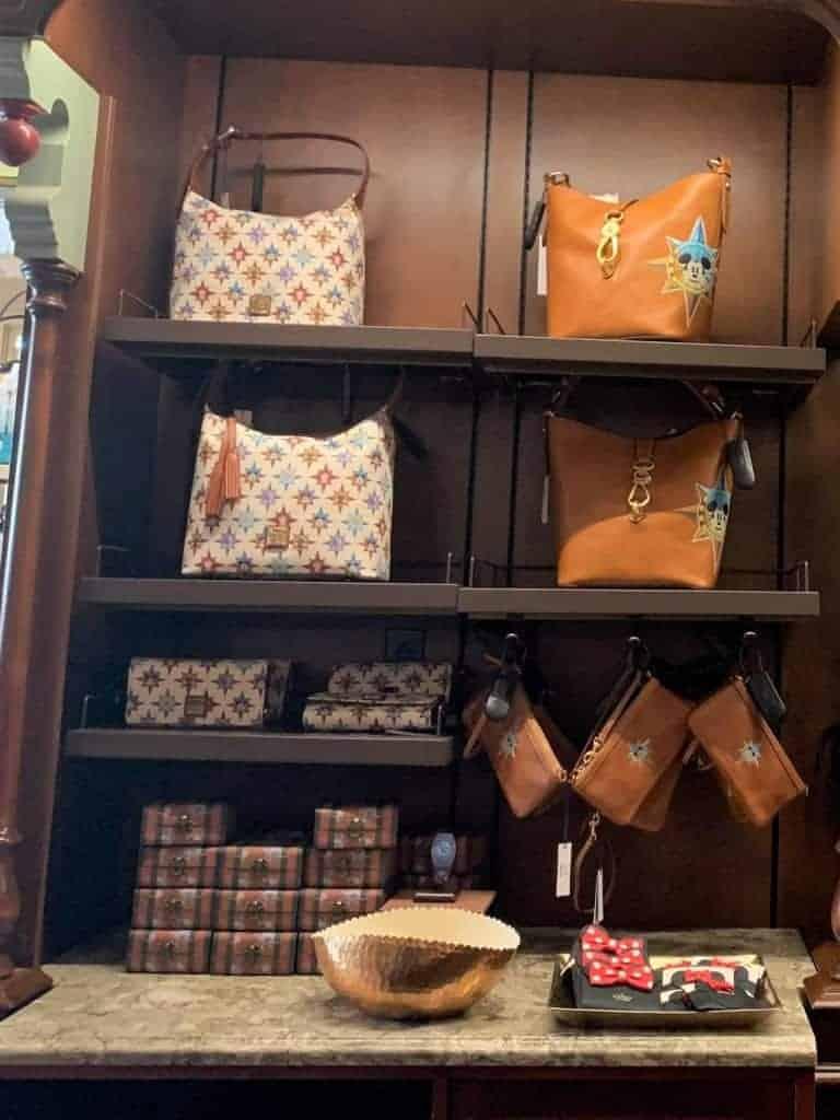 Disney Dooney & Bourke Passport Collection at Uptown Jewelers in Magic Kingdom