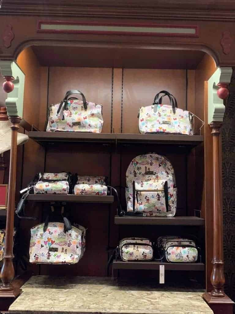 Disney Dooney and Bourke Sketch Collection at Uptown Jewelers in Magic Kingdom