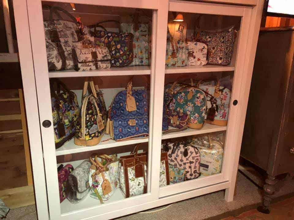 Storing Handbags in Sliding Glass Cabinet
