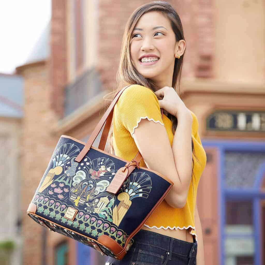Fantasia 80th Anniversary Tote with model by Dooney & Bourke